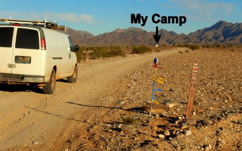 This is the turn-off toward my camp. I've put up a reflector with red, yellow and blue ribbons on it to help you spot it. You can see my camp up ahead.