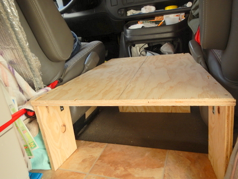 "Here you can see how we built the box.  We cut a 3/4 inch piece of plywood to fit in the space available and cut three pieces of the same plywood as legs. We screwed down into the legs and alo used ""L"" brackets for extra strength."