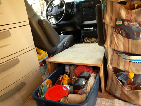 We built the box as a triangle to fit in the area and the height to allow a Rubermaid tote to slide in and out. It's also low enough that Judy can step on it to get in and of the back and it is also doesn't block access into the glove box on the dog house.